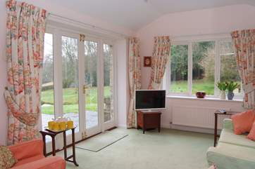 At the other end of the living room, French windows take you out onto the patio and the garden beyond.