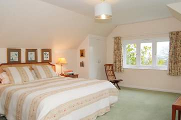 This is the master bedroom.  A really spacious room with a 6ft bed and the most beautiful panoramic views.