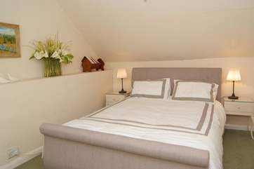 The comfortable double bedroom shares the family bathroom