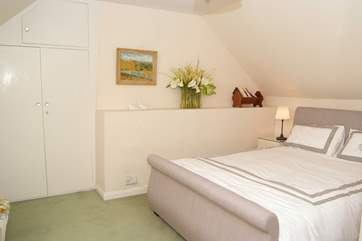 Another view of the double bedroom with its king sized bed.