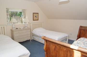 This is the family room - up its own staircase ! There are three single beds and a truckle bed making four. All are 3ft beds so good for adults too.