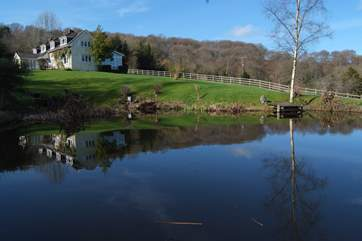 The house reflected in the lake - this is the most stunning setting for a holiday in the countryside.
