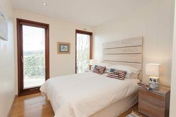 Enjoy your morning coffee in bed, with views out to Bembridge Harbour