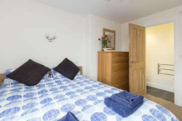 This is the double bedroom at the front of the cottage. It has a very useful little en suite WC with a wash-basin.