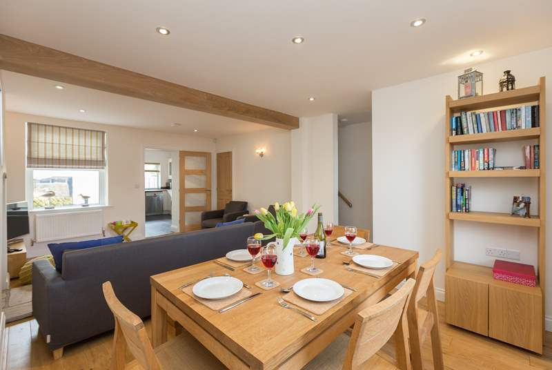 The cottage has a warm and welcoming open plan sitting/dining area with stylish furniture and wooden floors.