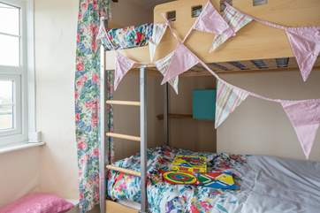 This children's bunk-bed room is cosy and exciting for the children in your family.