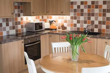 Cook up a meal for the family in the lovely kitchen.