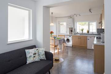 The open plan living is ideal for watching the littles ones whilst you relax on the sofa