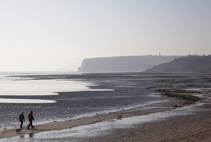 Walk along the picturesque beach and walk along to Wightcliff Bay