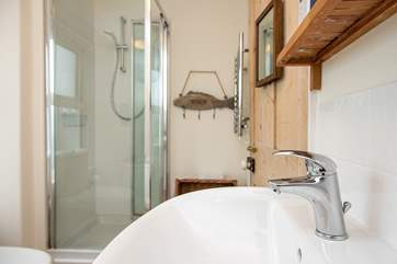 The bathroom also has a separate shower.
