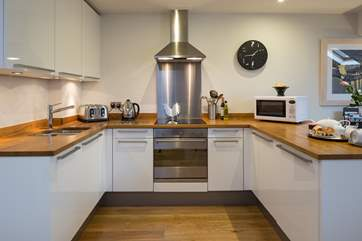 The spacious kitchen-area awaits fully equipped with a freshly laid cream tea - the perfect welcome!
