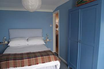 Bedroom 2, with sea views, has an en suite shower-room.