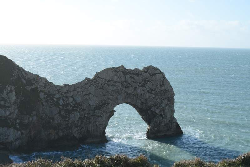 Durdle Door, an iconic feature on the Jurassic Coast. You can park nearby and take the steep walk down or park at Lulworth Cove and take the steep walk from there.