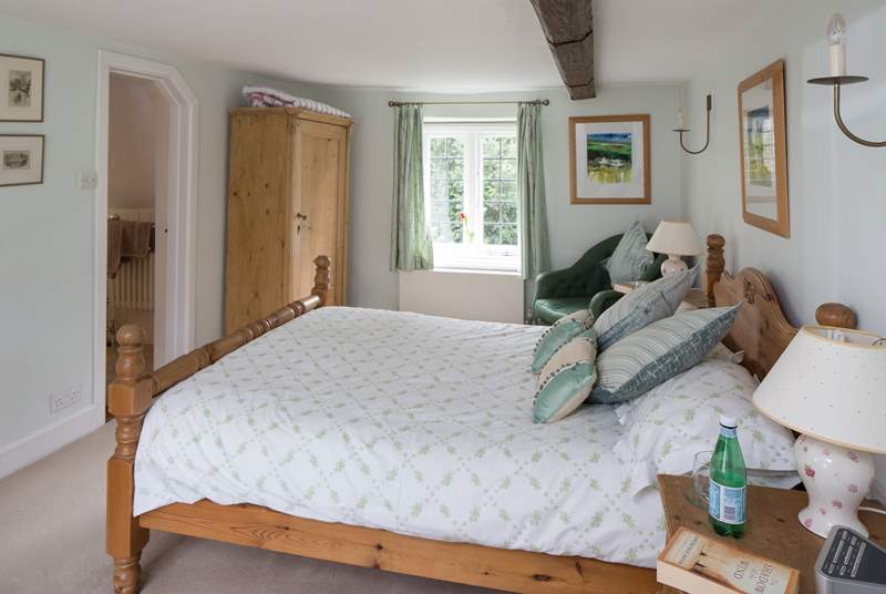 The master bedroom is both large and dual-aspect, with views over the garden at the back and the castle to the front.