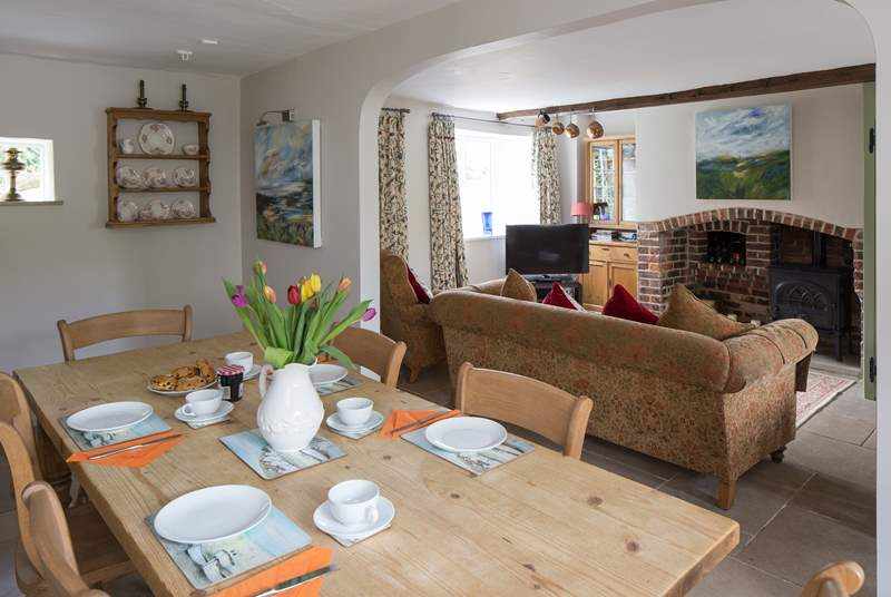 The sitting-room is very comfortable with cosy underfloor heating and doors that open onto the enclosed garden.