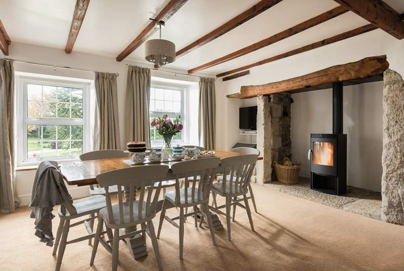 The dining-room has a wonderful wood-burner for cosy meals in and over looks the garden.