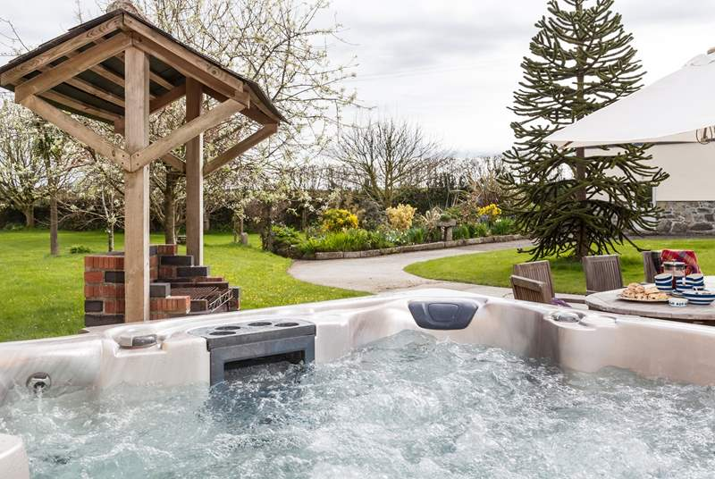 What a spot! Relax in the hot tub looking over the fabulous garden.