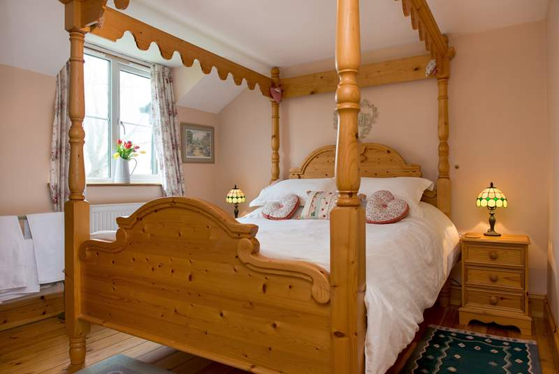 The gorgeous four-poster bed in bedroom 2.