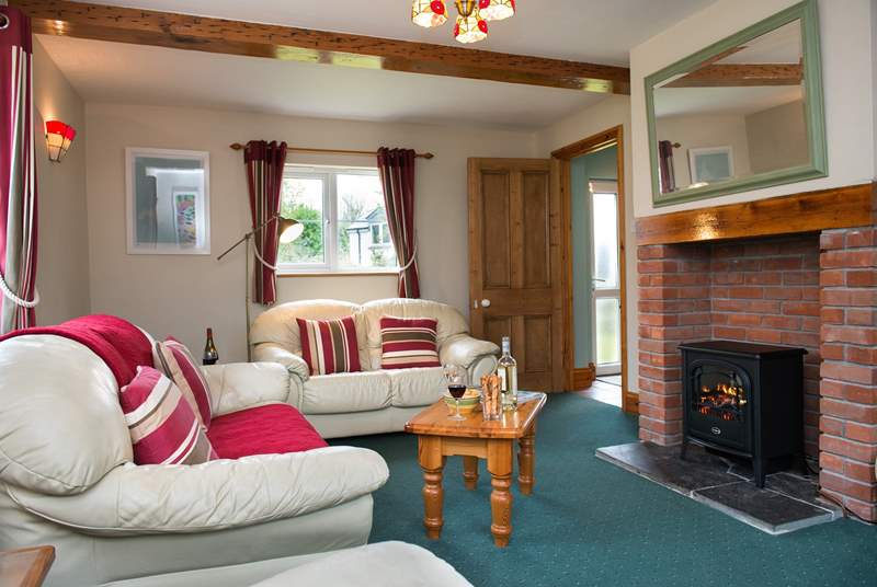 The electric fire makes the sitting-room warm and cosy all year round.