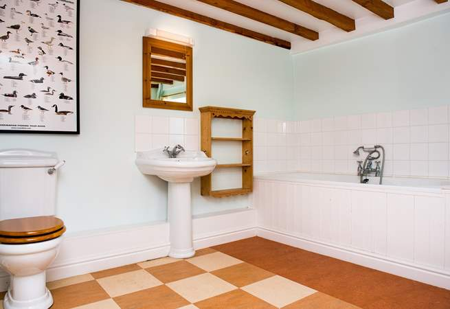 The main bathroom is very spacious. There is also a shower-room on the first floor.