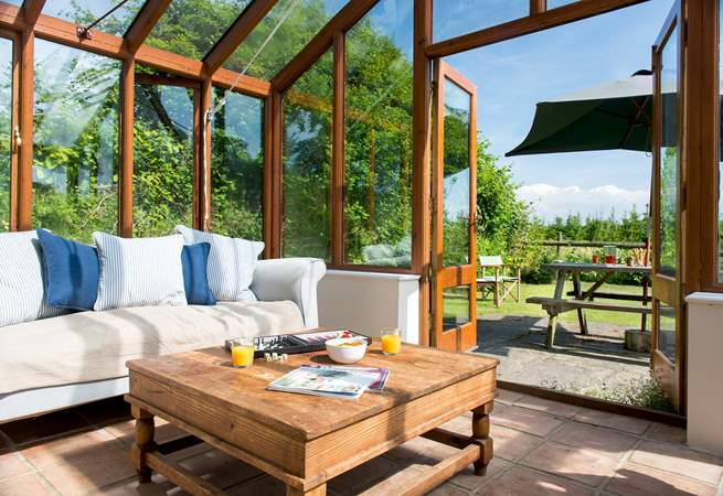 The conservatory provides the ideal place to sit back and enjoy the wonderful setting.