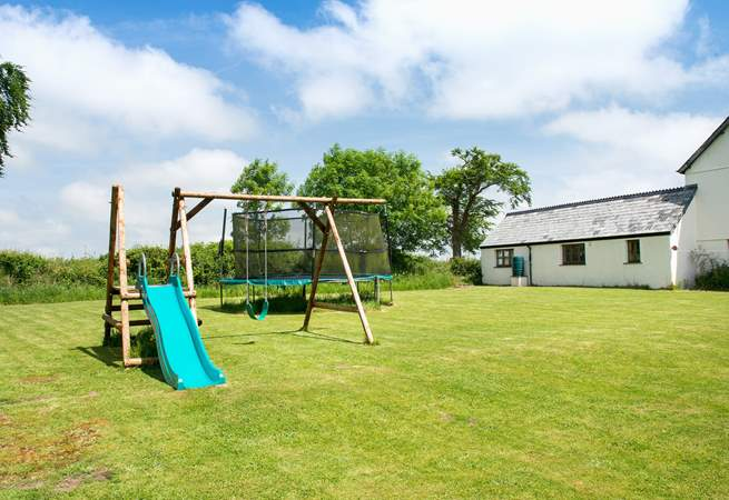Next to the house is a large communal play-area