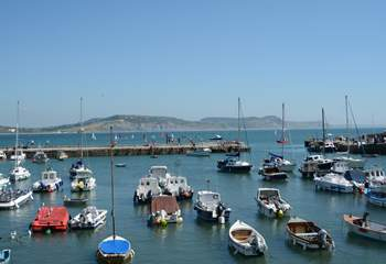 Lyme Regis is still a working fishing port, Golden Cap in the background is the highest point on the south coast.