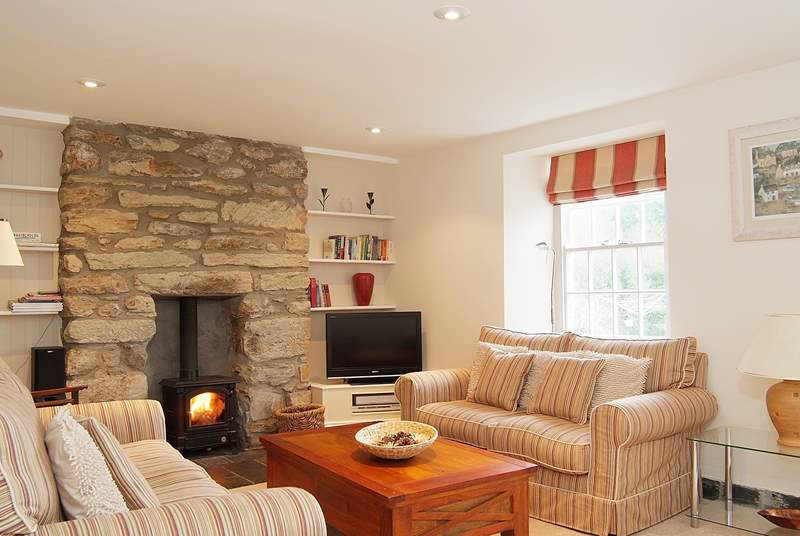 The beautifully furnished sitting-room is extremely comfortable and welcoming.