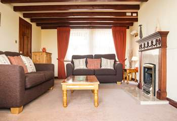 Comfortable sofas, a coal-effect gas fire and TV with Freesat...all perfect for family film nights.