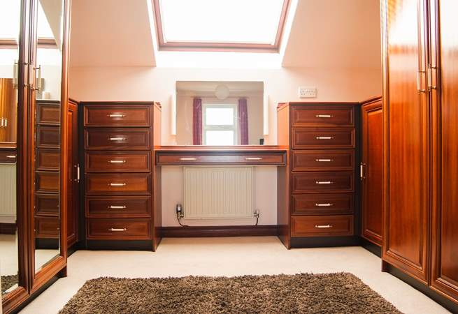 There is a separate dressing-area in Bedroom 1.