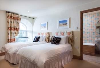 The twin bedroom (Bedroom 2) has an en suite bathroom.