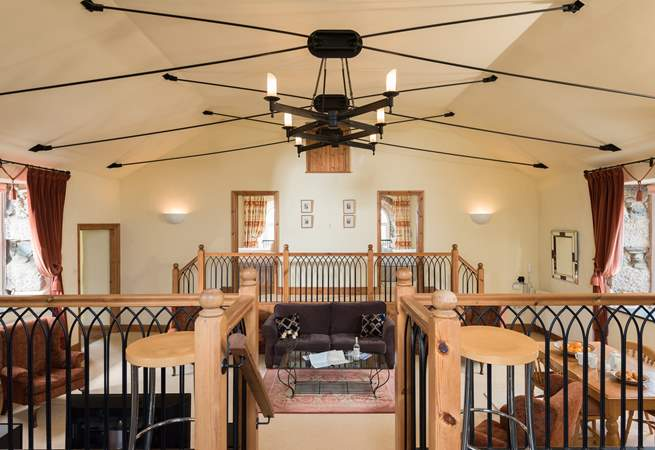 The high ceilings and wonderful light fitting, add to the feeling of space in this amazing cottage.