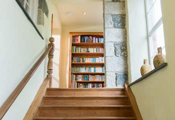 The wide staircase leading up to the apartment has a cosy window seat at the top, an ideal spot for quiet contemplation, or reading a good book.