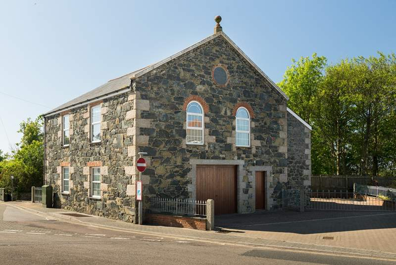 The chapel is in the heart of the village within walking distance of the shops, pub and restaurants, your gated parking is on the right.