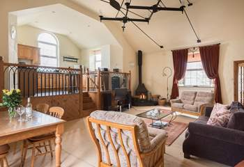 The beautifully furnished open plan living-room with dining-area.