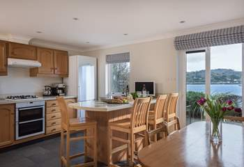 The kitchen/dining-room has doors out to the waterside terrace.
