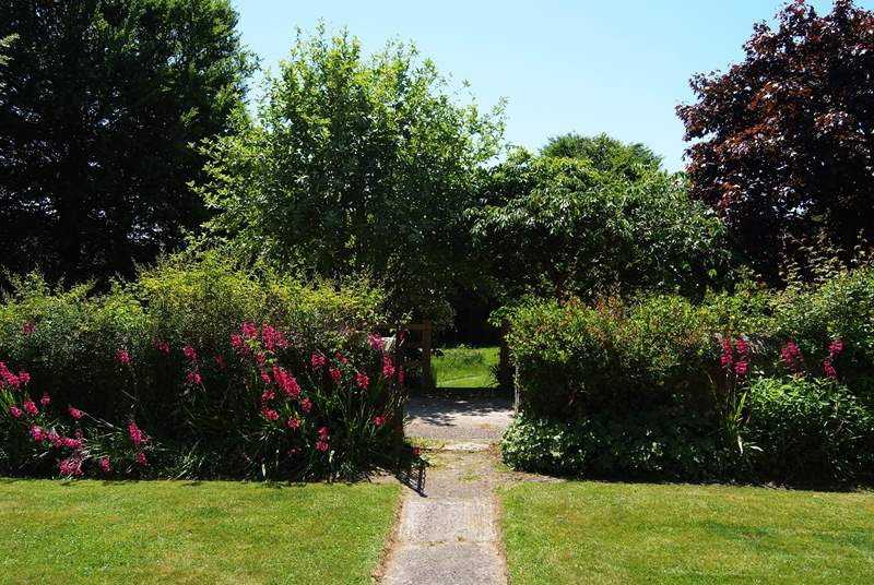 Looking through the gate opposite the entrance to Bay Tree Farmhouse, into the Owners' garden (which guests are welcome to use).