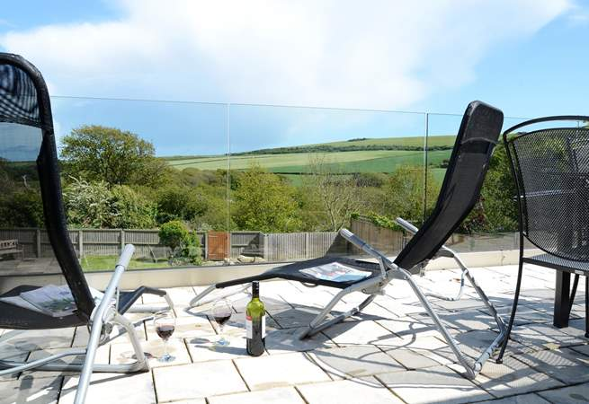 Relax with a glass of wine on the terrace and enjoy the wonderful views over the garden and countryside beyond.