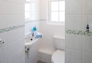 The ground floor bathroom has a shower cubicle.