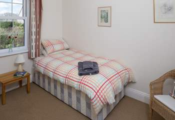 This single room looks out towards the village in one direction and the coast from the other window. (Bedroom 4)