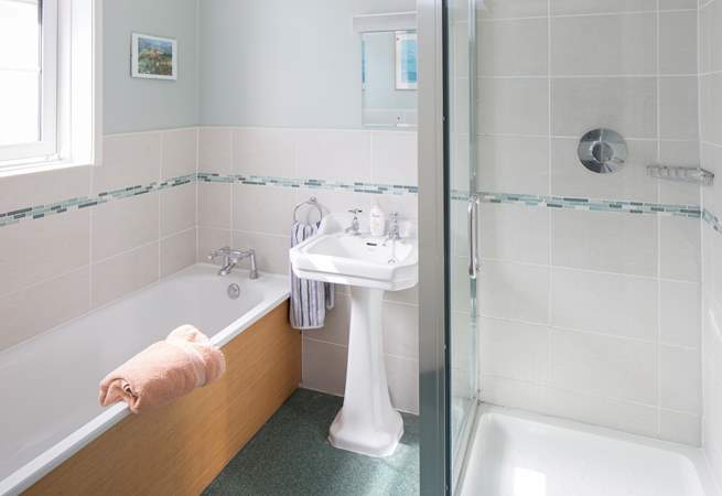 The first floor family bathroom has a shower cubicle.