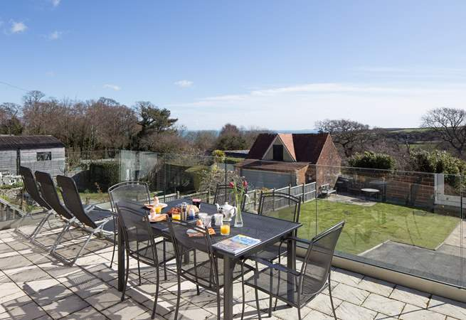 The fabulous terrace has far reaching views of the countryside, with the sea in the distance, on a clear day the Isle of Wight is visible.