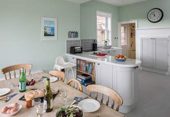 The spacious kitchen has all the equipment you could need; the utility-area is behind, with the back door in between.