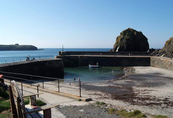 The harbour at Mullion Cove has a sandy beach at low tide.
