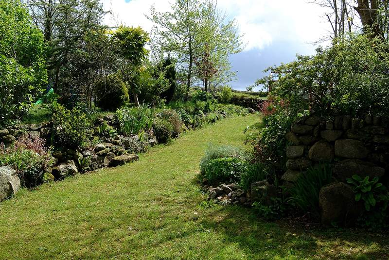 The sheltered garden for The Croft can be found just across the courtyard, next to the owners' garden.