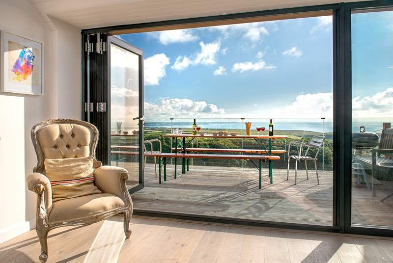 The large picture window, which leads out to the decking area, takes full advantage of the spectacular view.