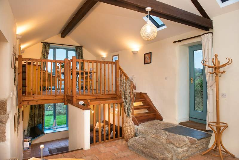 The kitchen, bedroom and bathroom are on the ground floor of this spacious barn conversion with stairs leading up to the dining-room and down to the sitting-room.