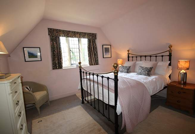 This is the double bedroom on the first floor. There is a feature Victorian fireplace.