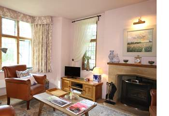 The truly comfortable sitting-room with its wood burning stove is at the heart of this lovingly presented cottage.