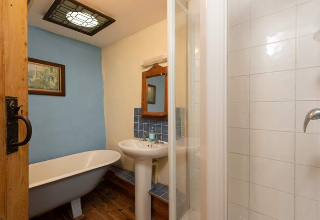 The bathroom, also on the first floor, offers an original roll-top bath as well as a shower cubicle.